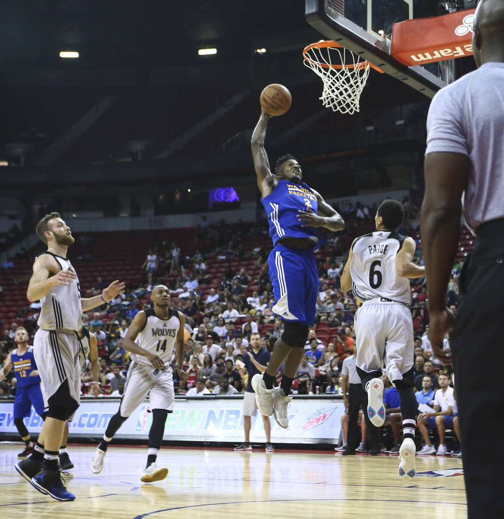 Golden State Warriors' Jordan Bell (2) goes to the basket against the Minnesota Timberwolves during a basketball game at the NBA Summer League at the Thomas & Mack Center in Las Vegas on Tuesd ...