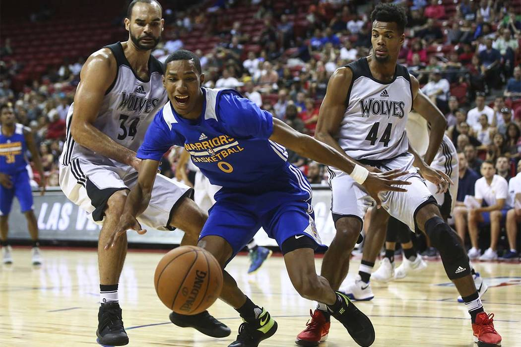 Golden State Warriors' Patrick McCaw (0) chases the ball against Minnesota Timberwolves' Perry Ellis (34) and Charles Cooke (44) during an NBA Summer League game at the Thomas & Mack Center in ...