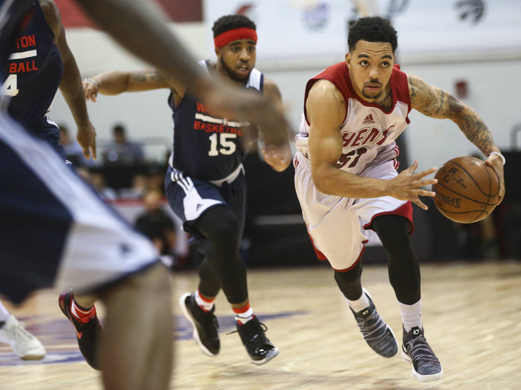 Miami Heat's Justin Robinson (51) drives to the basket during a basketball game against the Washington Wizards at the NBA Summer League at the Cox Pavilion in Las Vegas on Wednesday, July 12, 2017 ...