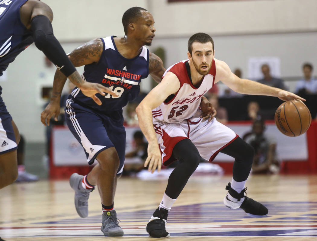 Miami Heat's Jake Odum (52) drives against Washington Wizards' Maalik Wayns (18) during a basketball game at the NBA Summer League at the Cox Pavilion in Las Vegas on Wednesday, July 12, 2017. Cha ...