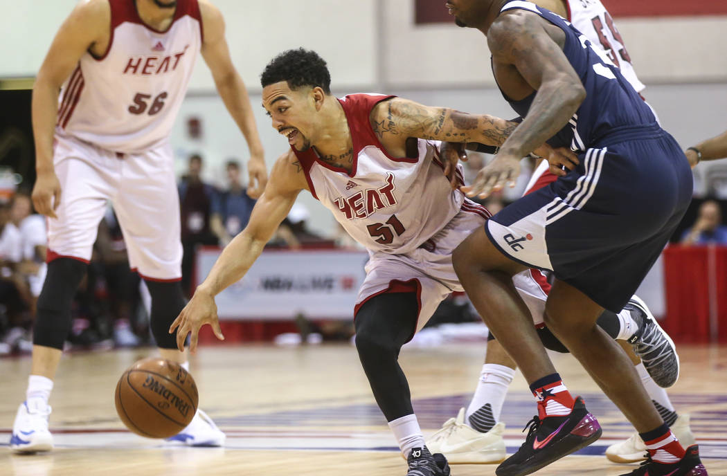 Miami Heat's Justin Robinson (51) drives the ball during a basketball game against the Washington Wizards at the NBA Summer League at the Cox Pavilion in Las Vegas on Wednesday, July 12, 2017. Cha ...