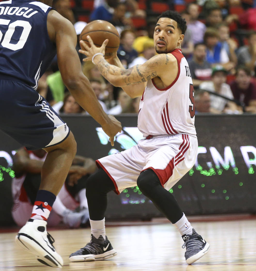 Miami Heat's Justin Robinson looks to pass during a basketball game against the Washington Wizards at the NBA Summer League at the Cox Pavilion in Las Vegas on Wednesday, July 12, 2017. Chase Stev ...