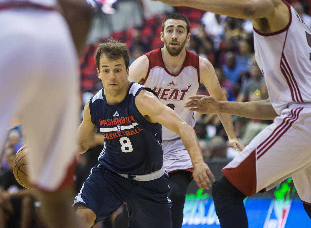 Washington Wizards' Kevin Pangos (8) drives against the Miami Heat during a basketball game at the NBA Summer League at the Cox Pavilion in Las Vegas on Wednesday, July 12, 2017. Chase Stevens Las ...