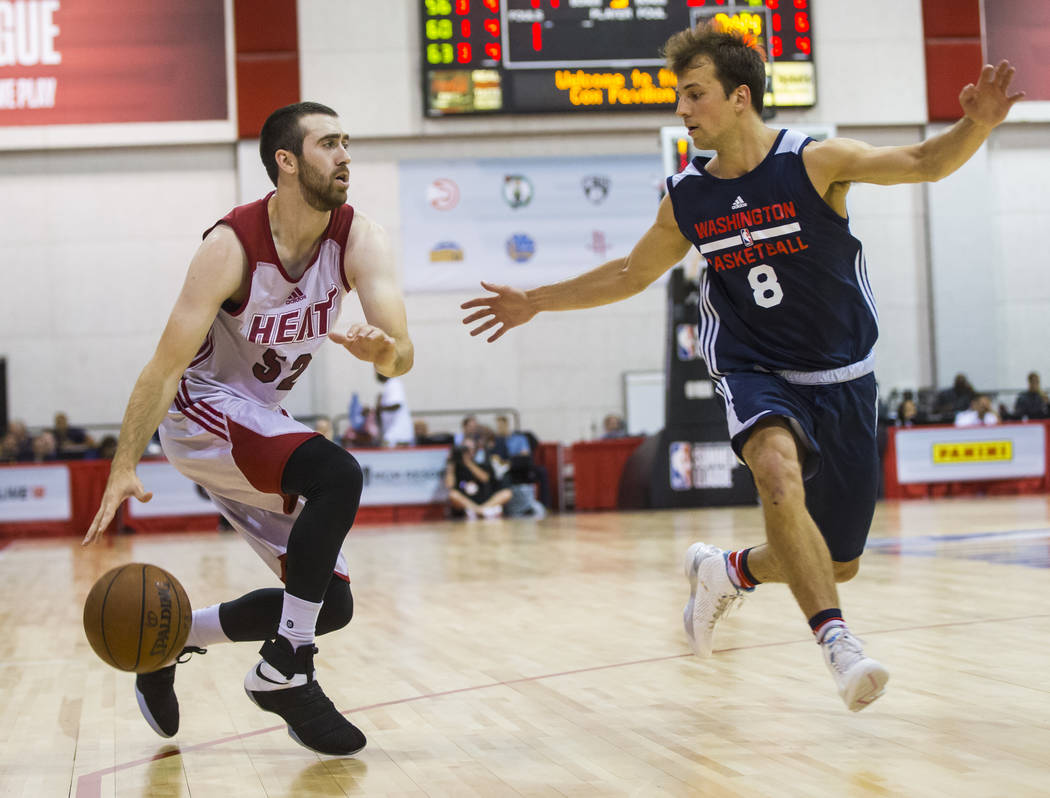 Miami Heat's Jake Odum (52) drives to the basket against Washington Wizards' Kevin Pangos (8) during a basketball game at the NBA Summer League at the Cox Pavilion in Las Vegas on Wednesday, July  ...