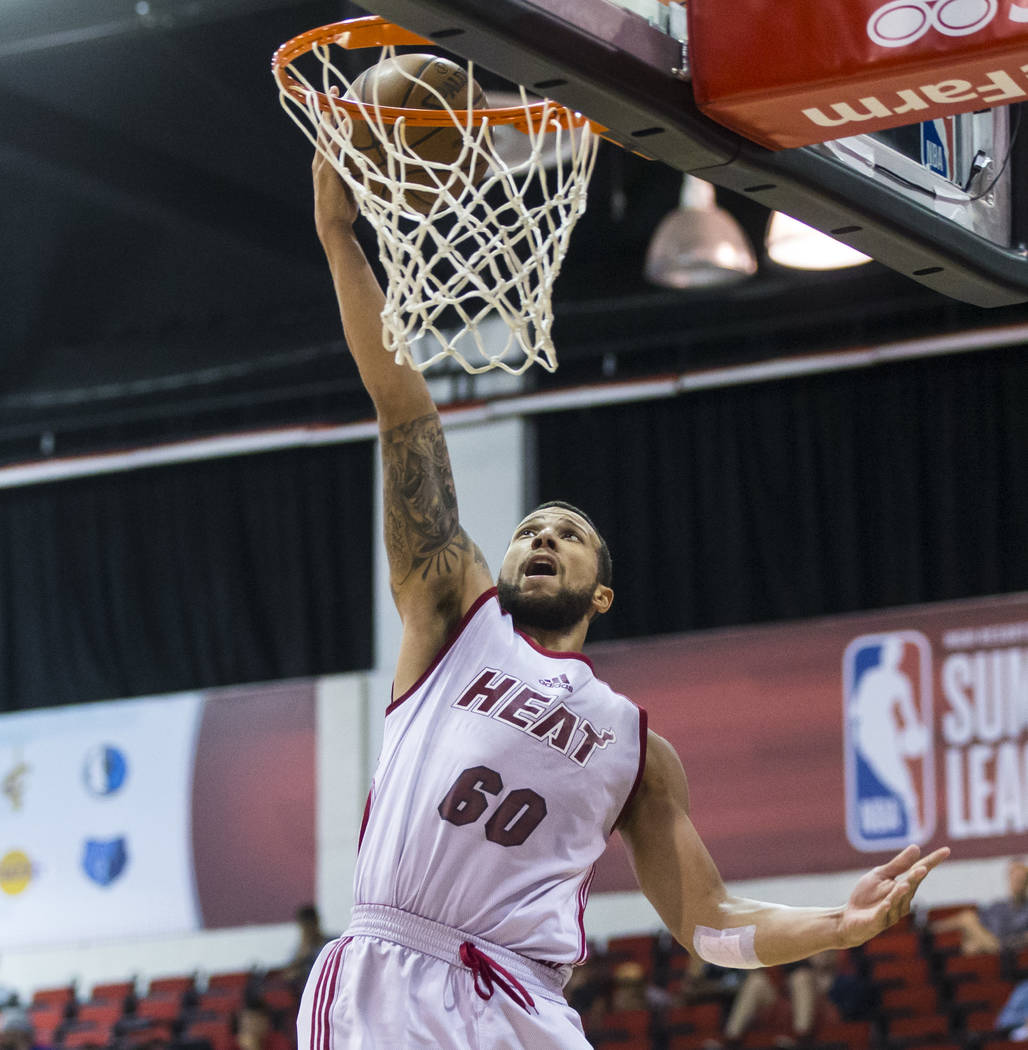 Miami Heat's Trey McKinney-Jones (60) goes to the basket against the Washington Wizards during a basketball game at the NBA Summer League at the Cox Pavilion in Las Vegas on Wednesday, July 12, 20 ...