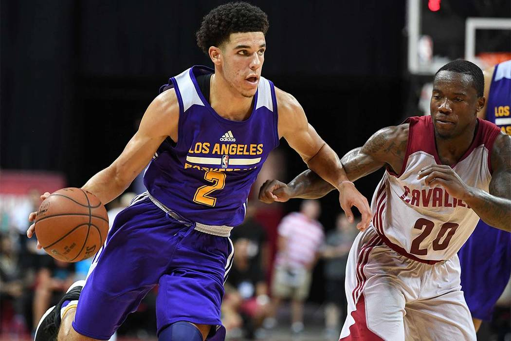 Los Angeles Lakers guard Lonzo Ball dribbles against Cleveland Cavaliers guard Kay Felder during Thursday's Summer League game at Thomas & Mack Center. Ball recorded a triple-double and the La ...