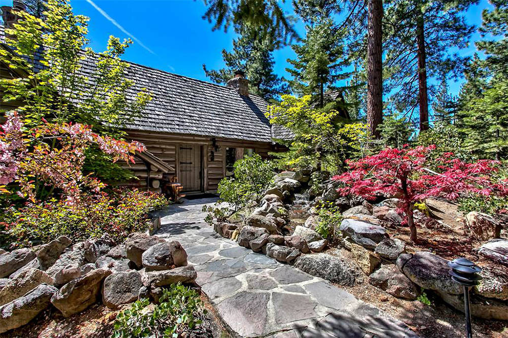 Sierra Sotheby's International Realty  On four lakefront acres surrounded by tall pines, it includes a renovated log home, water-front guest cottage, garage, private pier, boat lift and mooring  ...