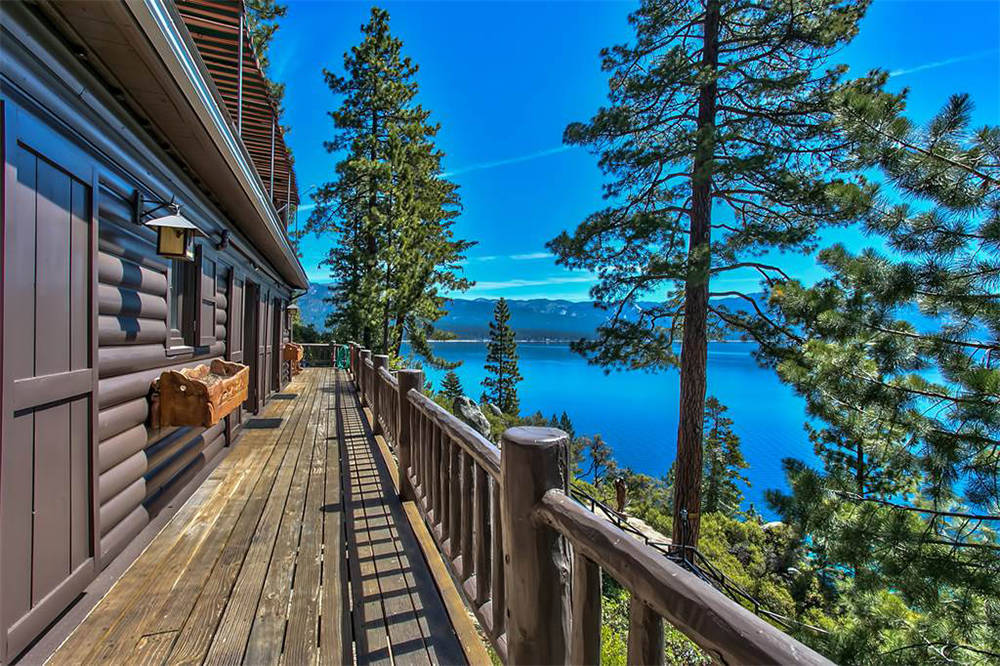 Sierra Sotheby's International Realty  The view is maximized by a sprawling porch facing the lake and a balcony off the upper floor.