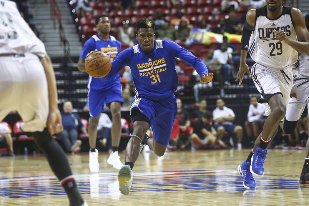Golden State Warriors' Dylan Ennis (31) drives against the Los Angeles Clippers during a basketball game at the NBA Summer League at the Thomas & Mack Center in Las Vegas on Friday, July 14, 2 ...