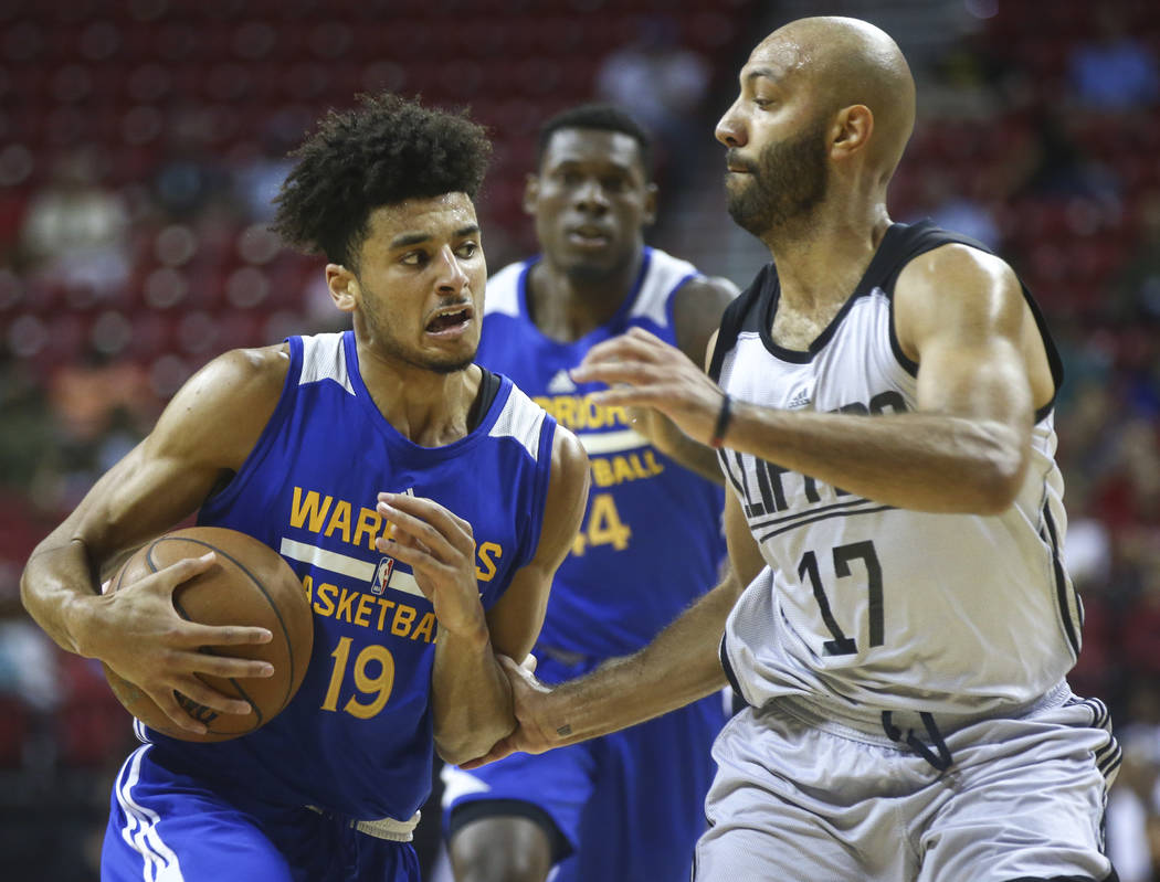 Golden State Warriors' Tai Webster (19) drives against Los Angeles Clippers' Kendall Marshall (17) during a basketball game at the NBA Summer League at the Thomas & Mack Center in Las Vegas on ...