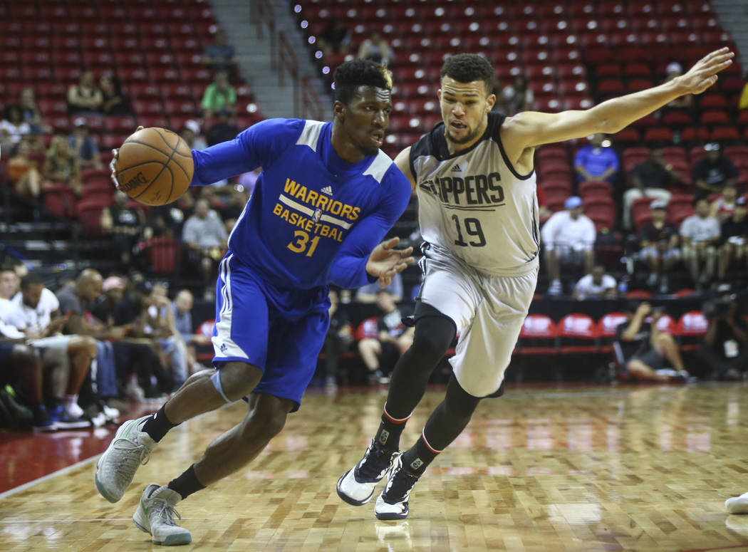 Golden State Warriors' Dylan Ennis (31) drives against Los Angeles Clippers' Luke Nelson (19) during a basketball game at the NBA Summer League at the Thomas & Mack Center in Las Vegas on Frid ...