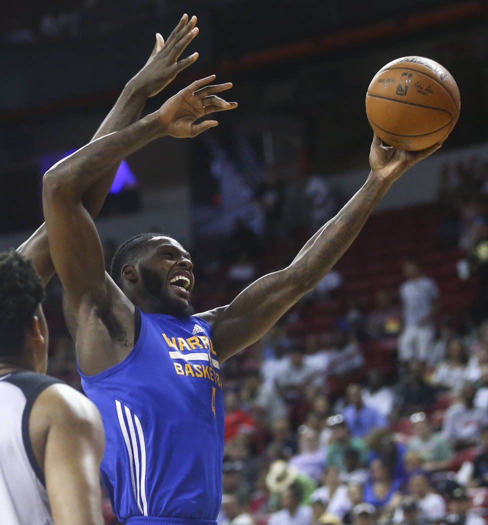 Golden State Warriors' JaCorey Williams (4) goes to the basket against the Los Angeles Clippers during a basketball game at the NBA Summer League at the Thomas & Mack Center in Las Vegas on Fr ...