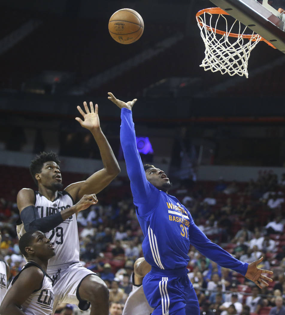 Golden State Warriors' Dylan Ennis (31) sends up a shot as Los Angeles Clippers' Shevon Thompson (29) defends during a basketball game at the NBA Summer League at the Thomas & Mack Center in L ...
