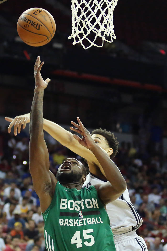 Boston Celtics guard Kadeem Allen goes up for a shot during the Celtics 2017 NBA Summer League game against the Dallas Mavericks at Thomas & Mack in Las Vegas on Saturday, July 15, 2017. Bridg ...