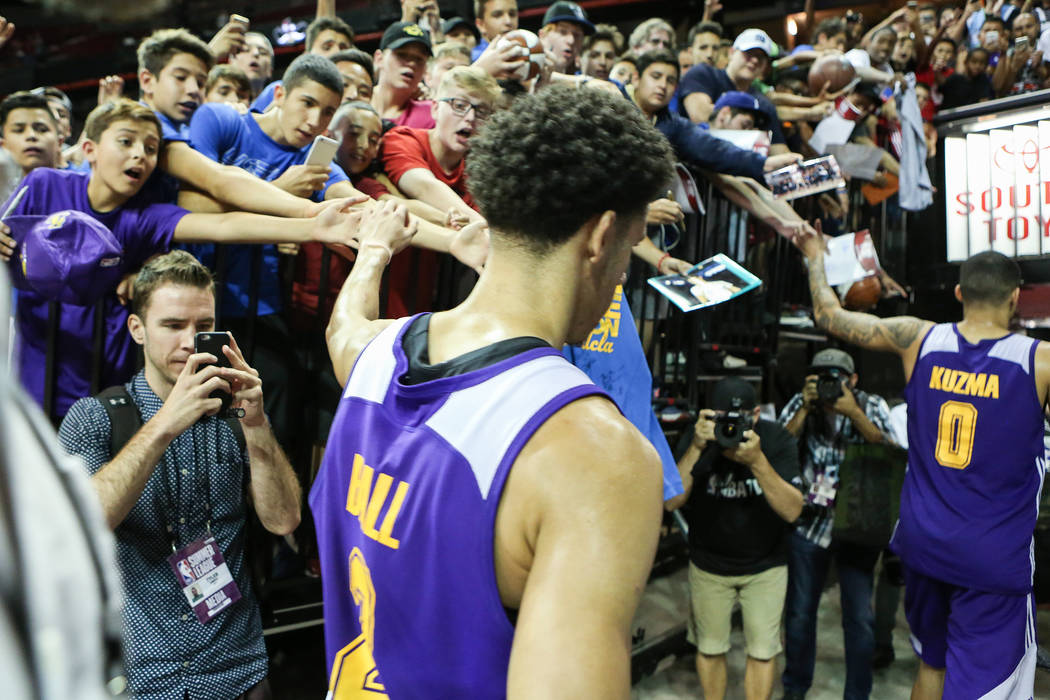 Los Angeles Lakers guard Lonzo Ball, left, and Los Angeles Lakers forward Kyle Kuzma, right, make their way off the court after their 2017 NBA Summer League game against the Brooklyn Nets at Thoma ...