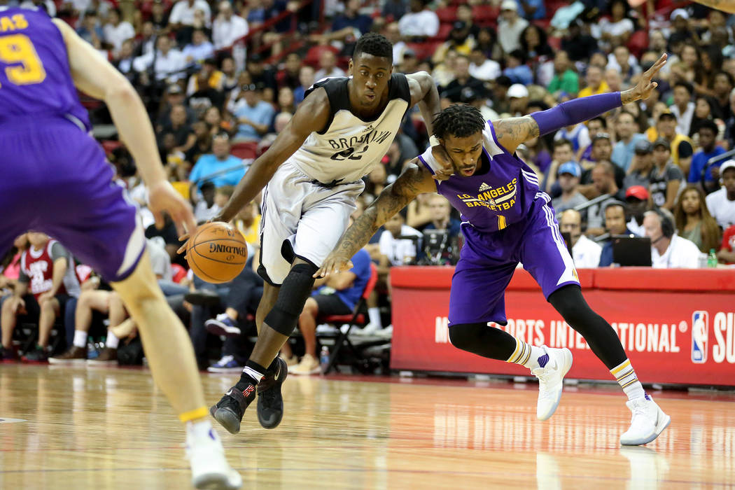 Los Angeles Lakers guard Vander Blue attempts to guard Brooklyn Nets player Chris LeVert as he brings the ball to the net during their 2017 NBA Summer League game at Thomas & Mack in Las Vegas ...