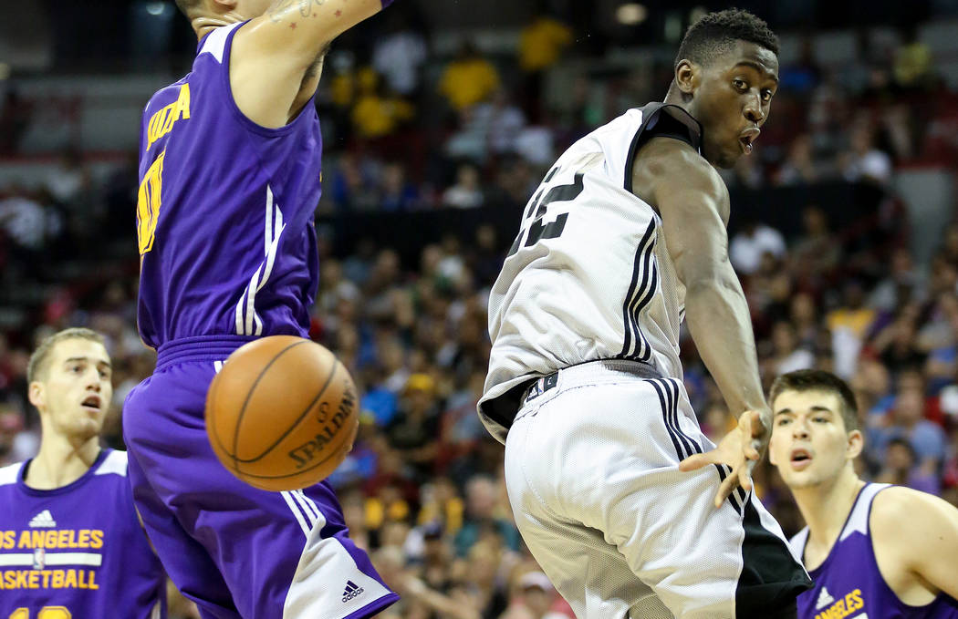 Brooklyn Nets player Chris LeVert passes the ball behind his back during the teams 2017 NBA Summer League game against the Los Angeles Lakers at Thomas & Mack in Las Vegas on Saturday, July 15 ...
