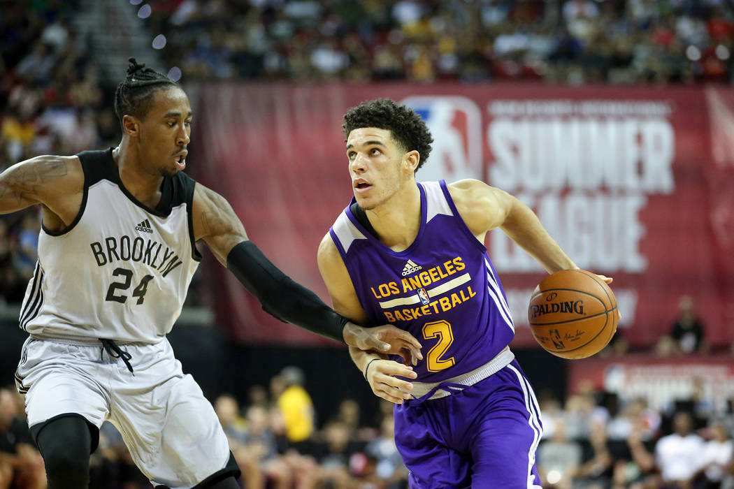 Brooklyn Nets guard Rondae Hollis-Jefferson (24) guards Los Angeles Lakers guard Lonzo Ball (2) as he brings the ball up the court during their 2017 NBA Summer League game at Thomas & Mack in  ...