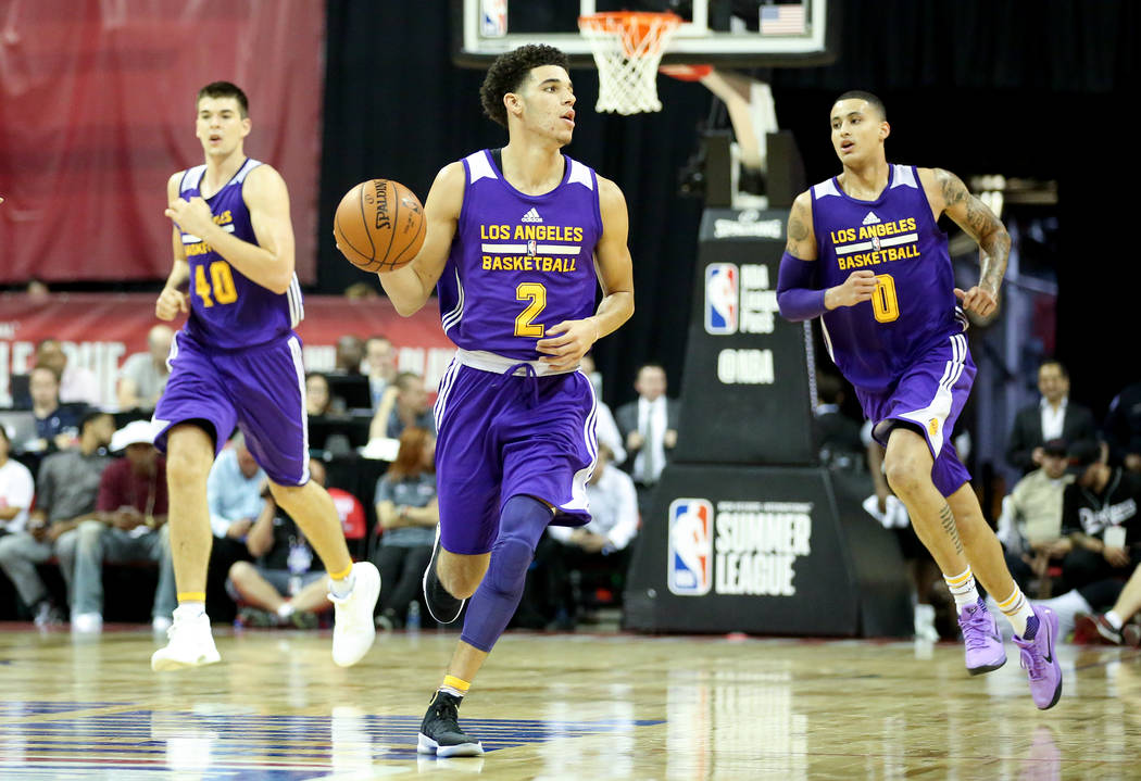 Los Angeles Lakers guard Lonzo Ball brings the ball up the court during the teams 2017 NBA Summer League game against the Brooklyn Nets at Thomas & Mack in Las Vegas on Saturday, July 15, 2017 ...