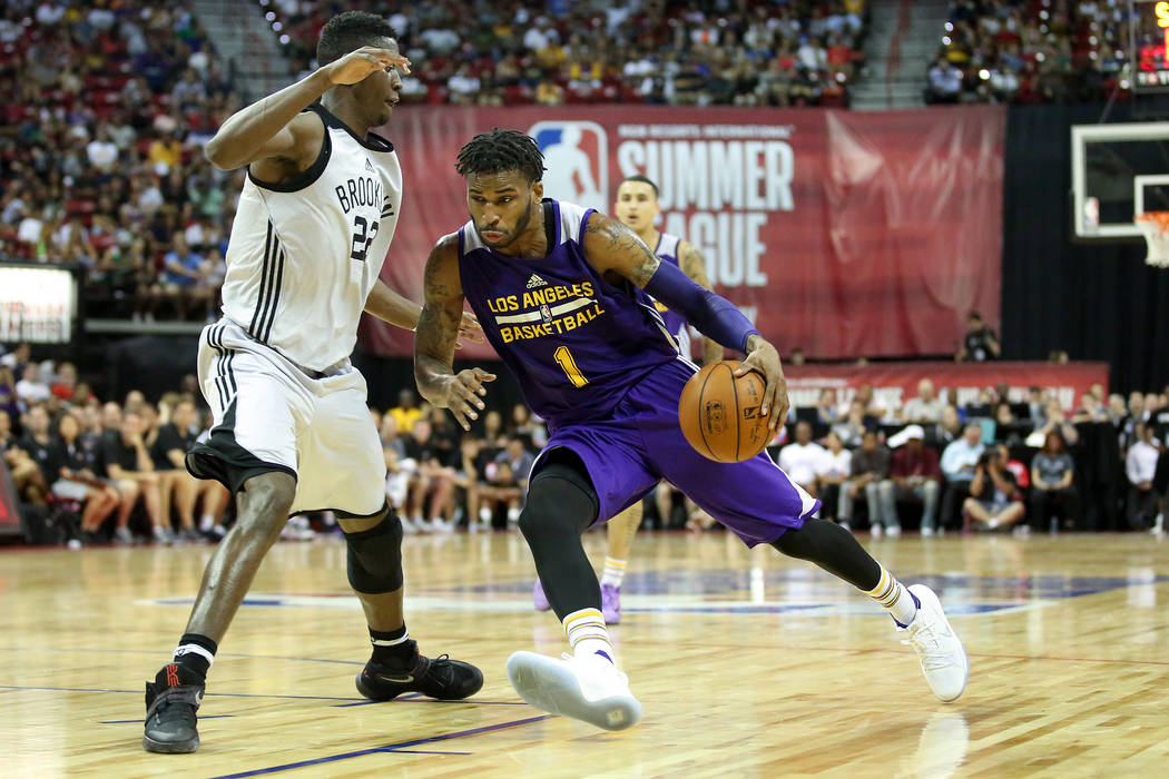 Brooklyn Nets player Chirs LeVert (22) guards Los Angeles Lakers guard Vander Blue (1) as he brings the ball to the net during their 2017 NBA Summer League game at Thomas & Mack in Las Vegas o ...
