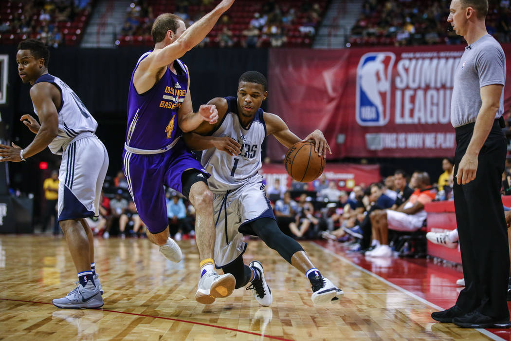 Dallas Mavericks guard Dennis Smith Jr. takes the ball down the court against Los Angeles Lakers guard Alex Caruso during the NBA Summer League semifinal game at Thomas and Mack Center on Sunday,  ...