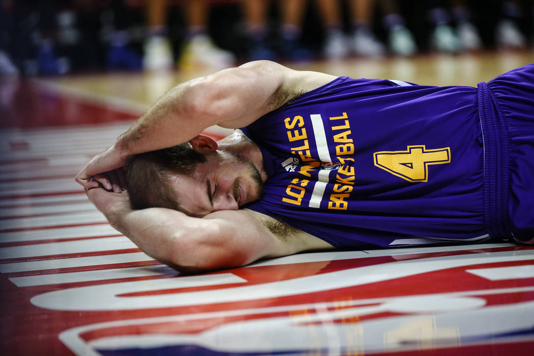 Los Angeles Lakers guard Alex Caruso takes a moment to himself after being knocked over during the NBA Summer League semifinal game at Thomas and Mack Center on Sunday, July 16, 2017, in Las Vegas ...