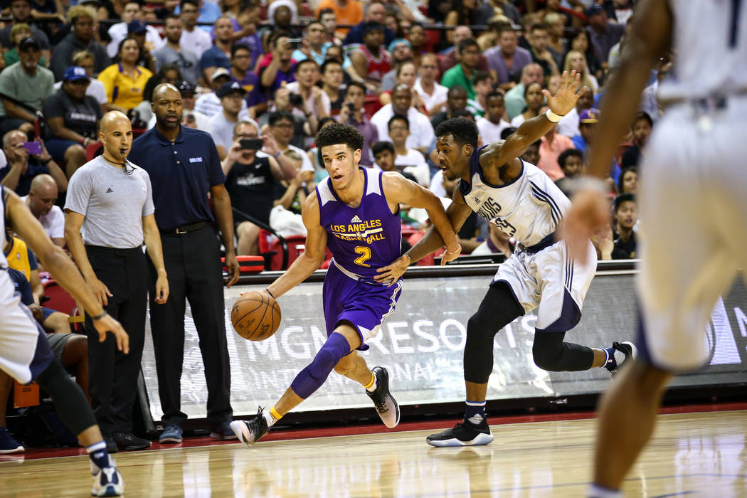 Los Angeles Lakers guard Lonzo Ball goes up against Dallas Mavericks forward Carrick Felix during the NBA Summer League semifinal game at Thomas and Mack Center on Sunday, July 16, 2017, in Las Ve ...
