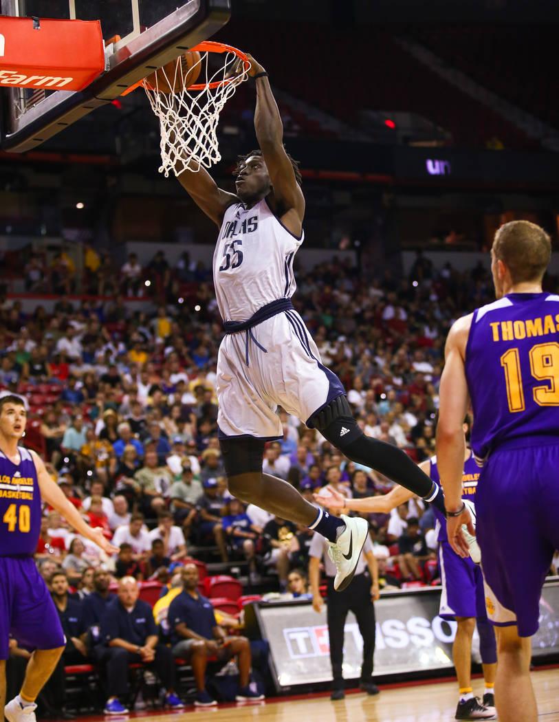 Dallas Mavericks forward Johnathan Motley goes for a slam dunk against Los Angeles Lakers guard Matt Thomas during the NBA Summer League semifinal game at Thomas and Mack Center on Sunday, July 16 ...