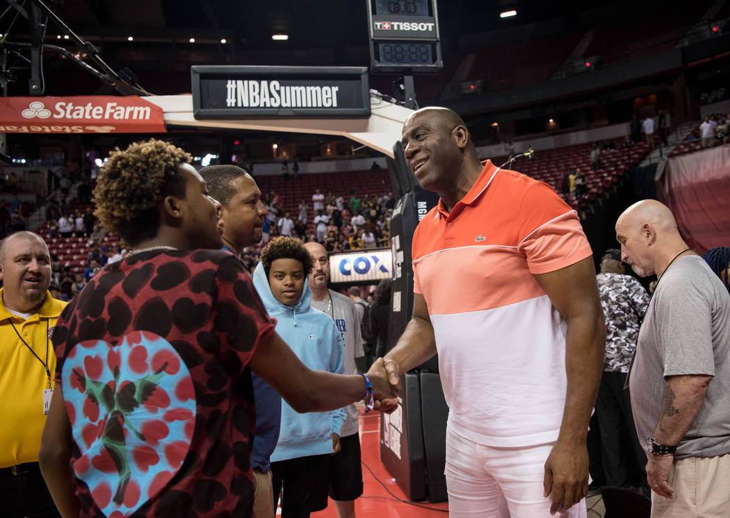 Magic Johnson meets with a fan after the NBA Summer League Lakers versus Mavericks semifinal game at Thomas and Mack on Sunday, July 16, 2017, in Las Vegas. Morgan Lieberman Las Vegas Review-Journal