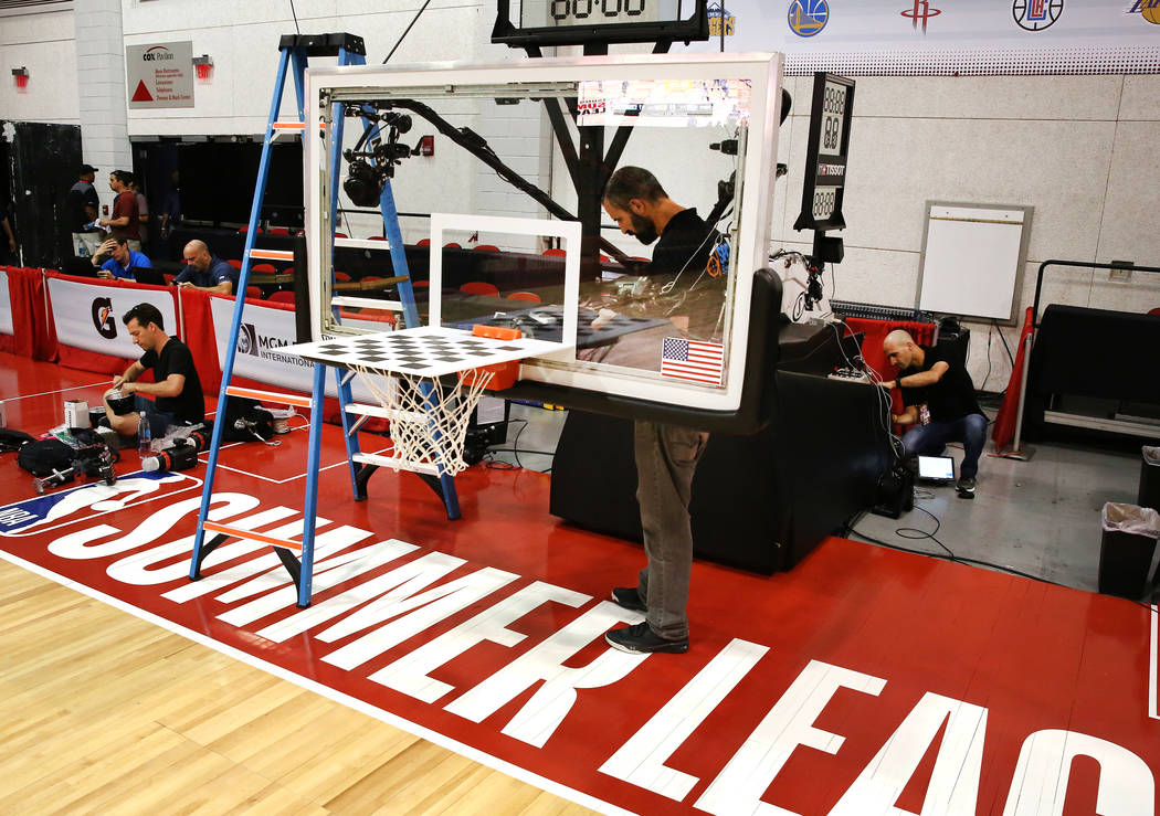 A worker installs remote cameras for the 2017 NBA Summer League at the Thomas & Mack Center on Thursday, July 6, 2017. Bizuayehu Tesfaye/Las Vegas Review-Journal @bizutesfaye