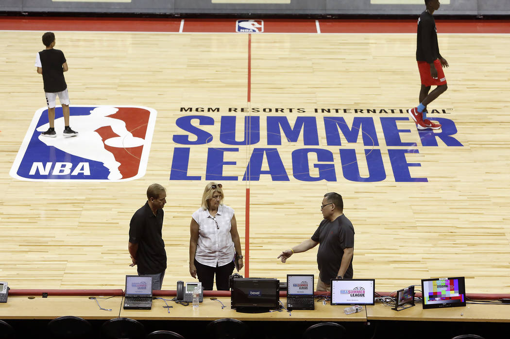 Workers install computers and broadcasting equipments for the 2017 NBA Summer League at the Thomas & Mack Center on Thursday, July 6, 2017. Bizuayehu Tesfaye/Las Vegas Review-Journal @bizutesfaye