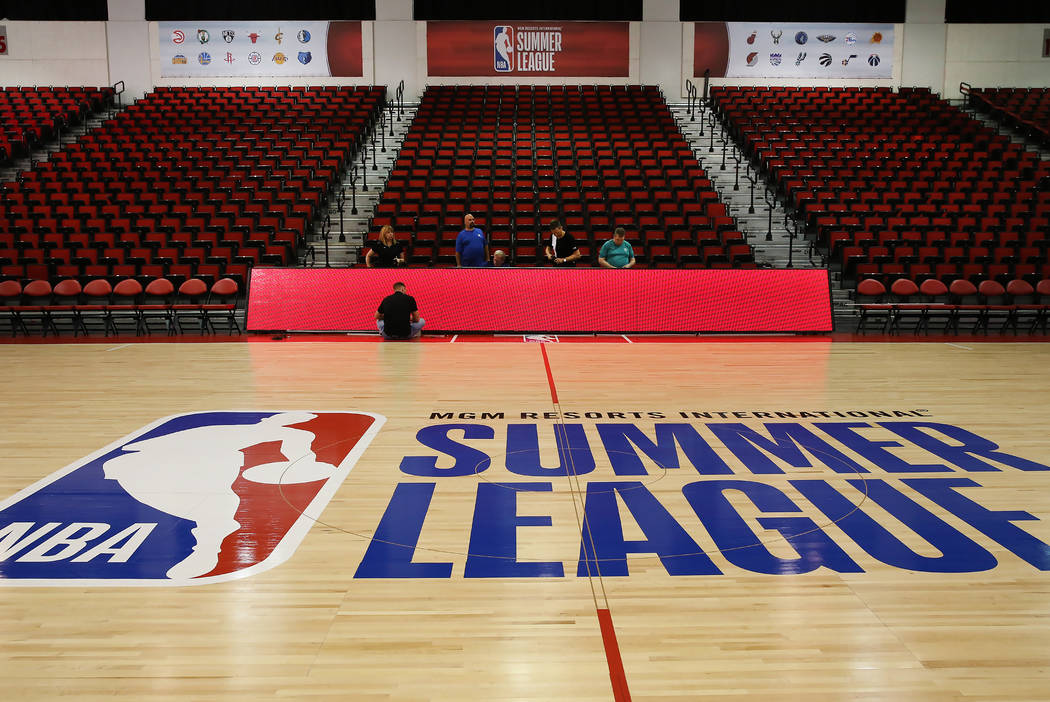 Workers install digital message board for the 2017 NBA Summer League at the Thomas & Mack Center on Thursday, July 6, 2017. Bizuayehu Tesfaye/Las Vegas Review-Journal @bizutesfaye