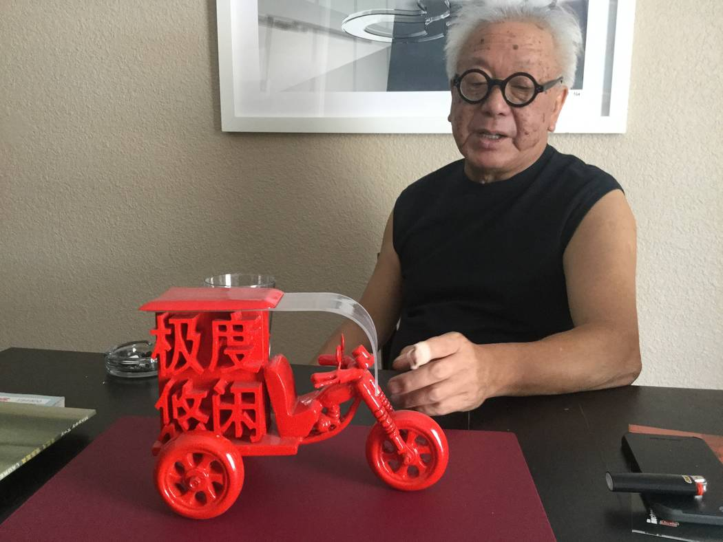 "Artist Laurens Tan explains his mixed media sculpture called ""Beng Beng"" in his home on July 5, 2017. The title stands for the sound three-wheel carts in rural China make while transporting people ..."