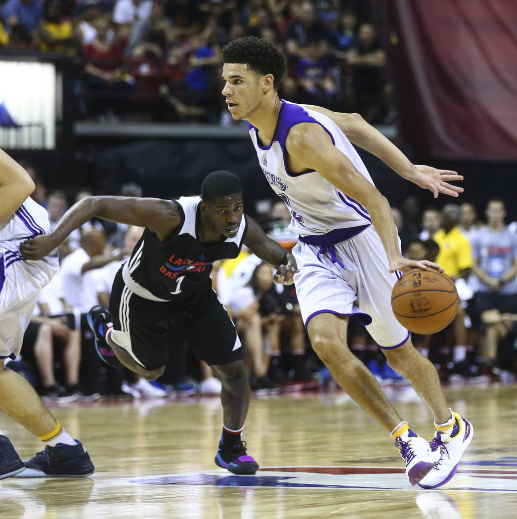 Los Angeles LakersՠLonzo Ball, right, drives against Los Angeles ClippersՠSindarius Thornwell during a basketball game at the NBA Summer League at the Thomas & Mack Center in Las V ...