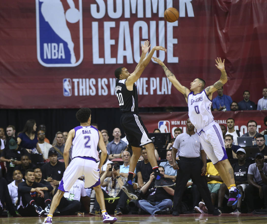 Los Angeles ClippersՠBrice Johnson (10) shoots over Los Angeles LakersՠKyle Kuzma (0) as Los Angeles LakersՠLonzo Ball (2) looks on during a basketball game at the NBA Summer Lea ...
