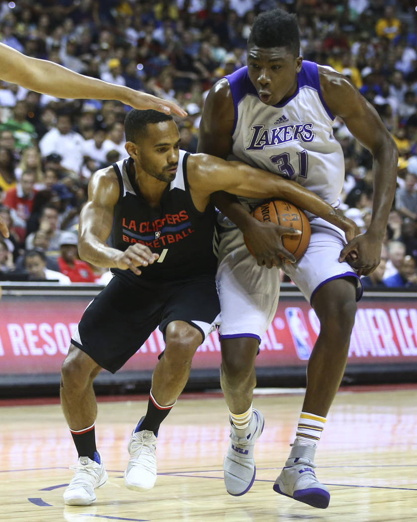 Los Angeles LakersՠThomas Bryant, right, tries to keep control of the ball against Los Angeles ClippersՠDavid Michineau during a basketball game at the NBA Summer League at the Thomas  ...