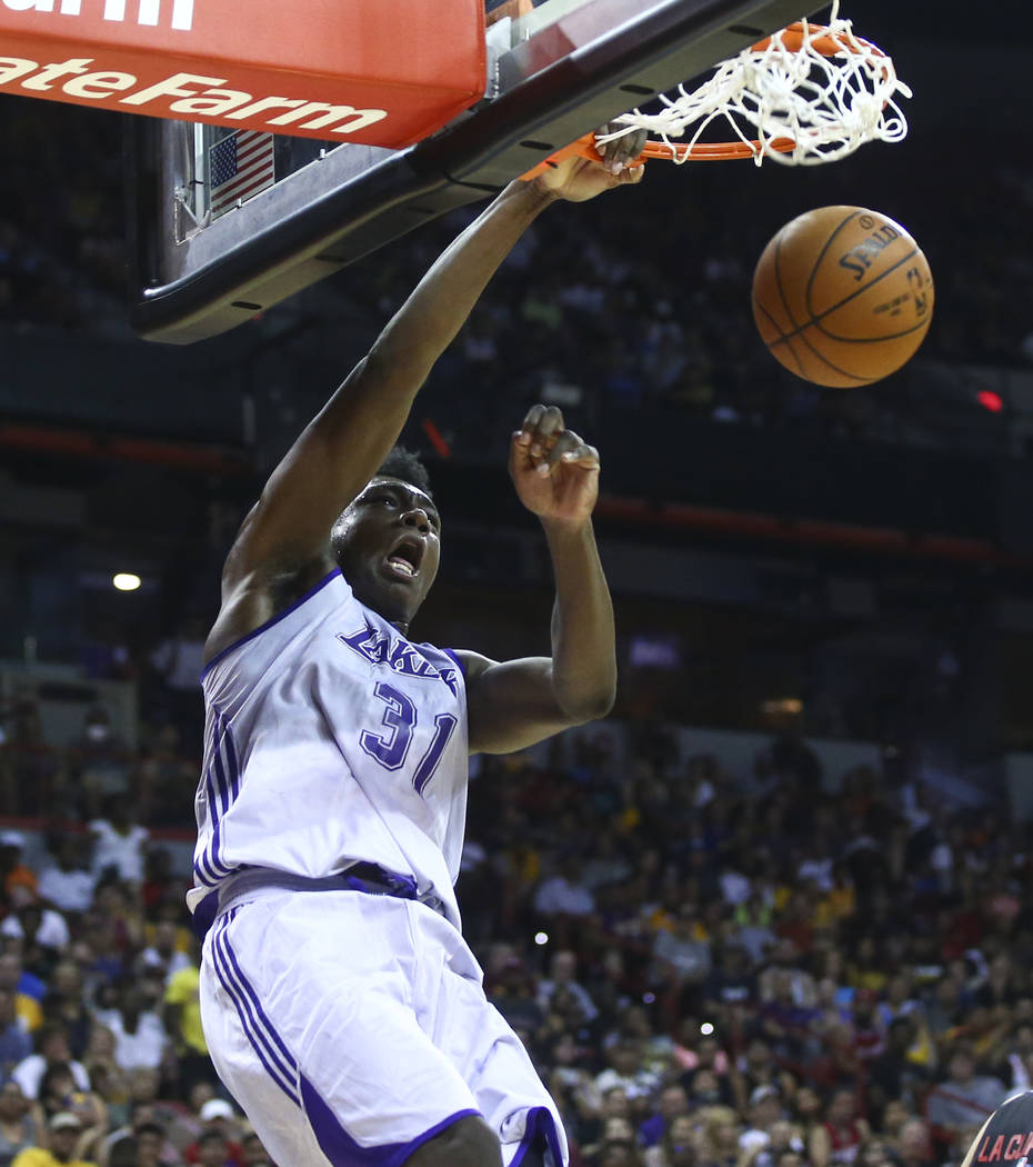Los Angeles LakersՠThomas Bryant dunks against the Los Angeles Clippers during a basketball game at the NBA Summer League at the Thomas & Mack Center in Las Vegas on Friday, July 7, 2017 ...