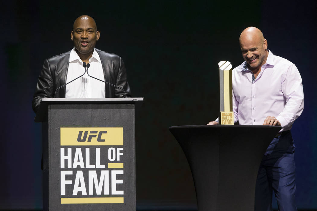 Maurice Smith, left, is inducted to the 2017 UFC Hall Of Fame after a speech by former mixed martial artist Bas Rutten during a ceremony at the Park Theater inside the Monte Carlo hotel-casino in  ...