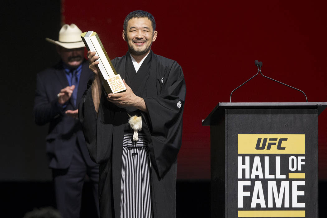 Kazushi Sakuraba, left, is inducted to the UFC Hall of Fame during an induction ceremony at the Park Theater inside the Monte Carlo hotel-casino in Las Vegas, Thursday, July 6, 2017. Erik Verduzco ...