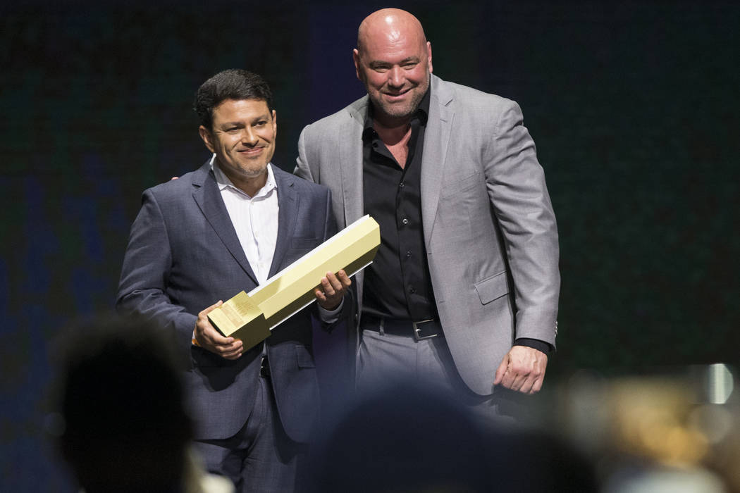 Joe Silva is inducted to the 2017 UFC Hall Of Fame after a speech by UFC President Dana White during a ceremony at the Park Theater inside the Monte Carlo hotel-casino in Las Vegas, Thursday, July ...