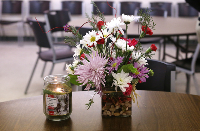 A candle and flowers in memory of David Dunn, one of the two homeless men killed near downtown Las Vegas since the start of the year, are placed where Dunn used to sit at Reformation Lutheran Chur ...