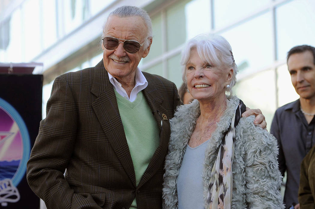 Comic book creator Stan Lee, left, poses with his wife Joan after he received a star on the Hollywood Walk of Fame in Los Angeles in 2011. (AP Photo/Chris Pizzello, File)