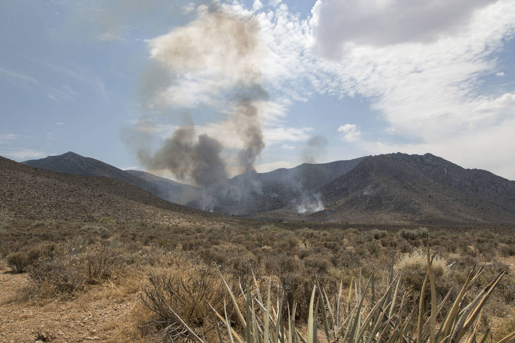 A wildfire burning on the Pahrump side of Mount Potosi southwest of Las Vegas on Friday, July 7, 2017.  (Richard Brian/Las Vegas Review-Journal) @vegasphotograph