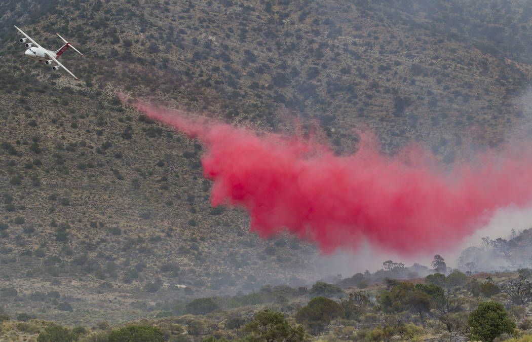 An air tanker drops a load of fire retardant while fighting a wildfire burning on the Pahrump side of Potosi Mountain on Friday, July 7, 2017.  Richard Brian Las Vegas Review-Journal @vegasphotograph