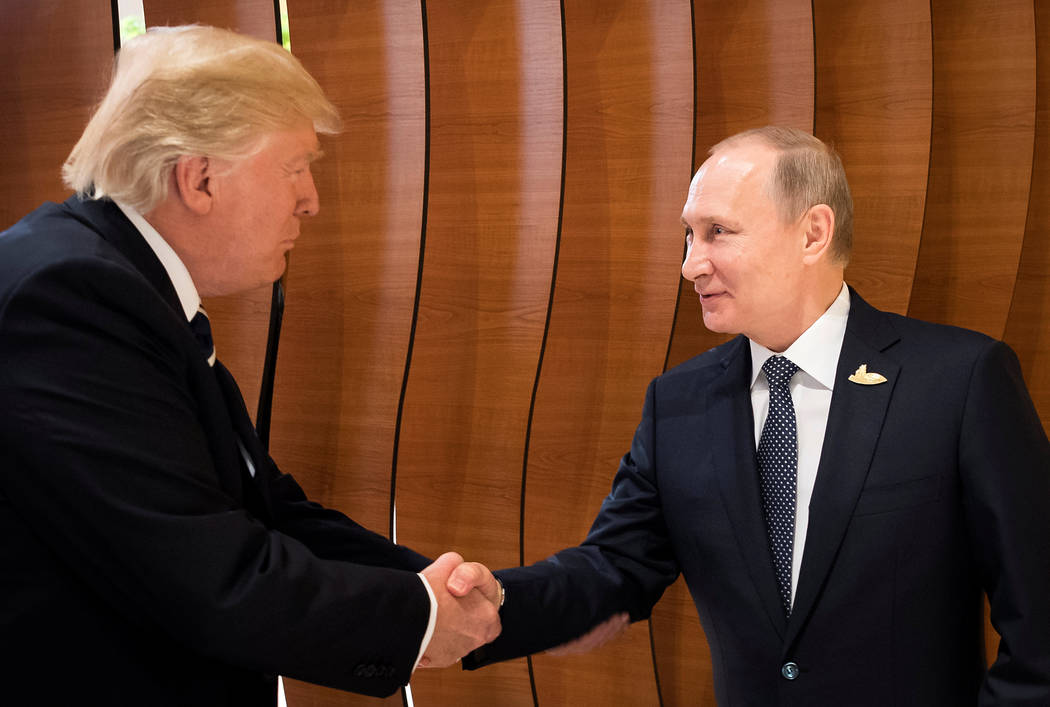 U.S. President Donald Trump and Russia's President Vladimir Putin shake hands during the G20 Summit in Hamburg, Germany in this still image taken from video, July 7, 2017. REUTERS/Steffen Kugler/C ...