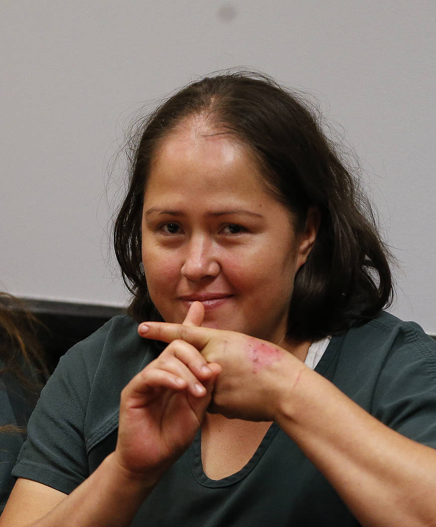 Isabel Martinez gestures towards news cameras during her first court appearance Friday, July 7, 2017, in Lawrenceville, Ga. Martinez is charged with killing four of her of children and their fathe ...