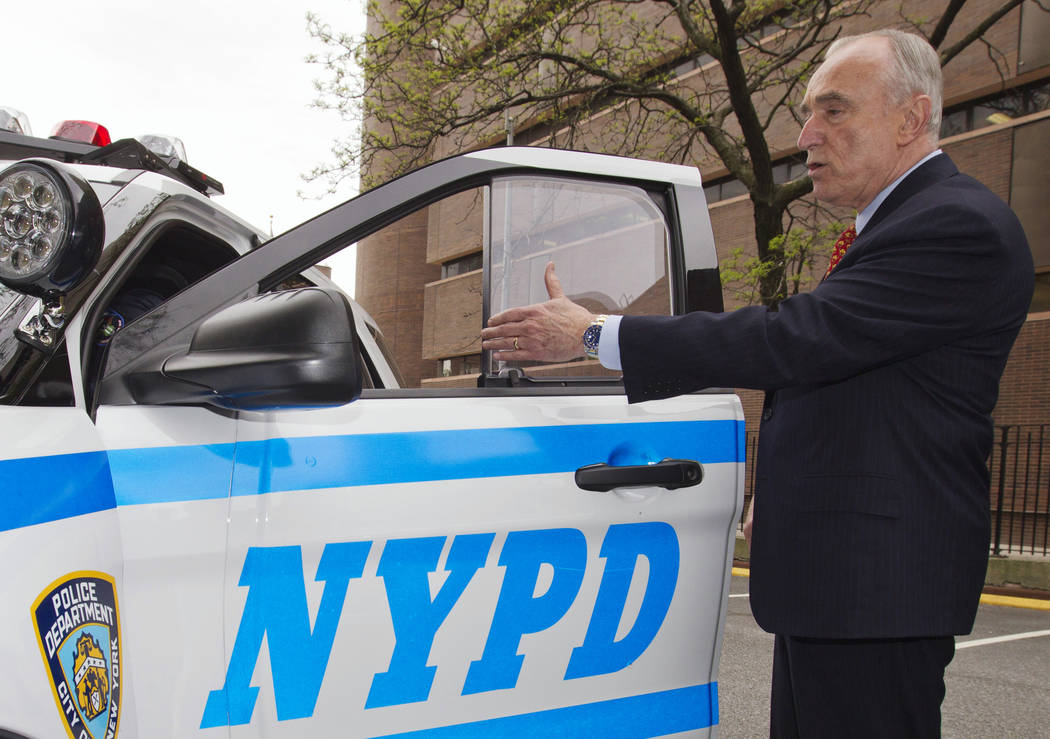 In this May 10, 2016, photo, New York Police Commissioner William Bratton displays new bullet resistant windows and door panels during a news conference in New York. After two officers were fatall ...