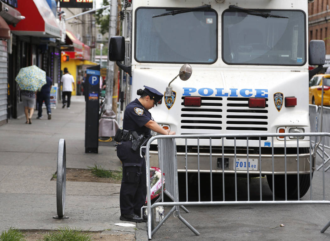 A police officer works near the site where an officer was killed in the Bronx section of New York, Thursday, July 6, 2017.  Police officer Miosotis Familia was shot to death early Wednesday, ambus ...