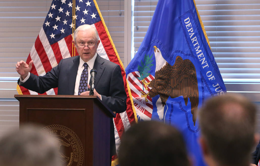 U.S. Attorney General Jeff Sessions speaks to federal, state and local law enforcement officials about sanctuary cities and efforts to combat violent crime on Wednesday, July 11, 2017, in Las Vega ...