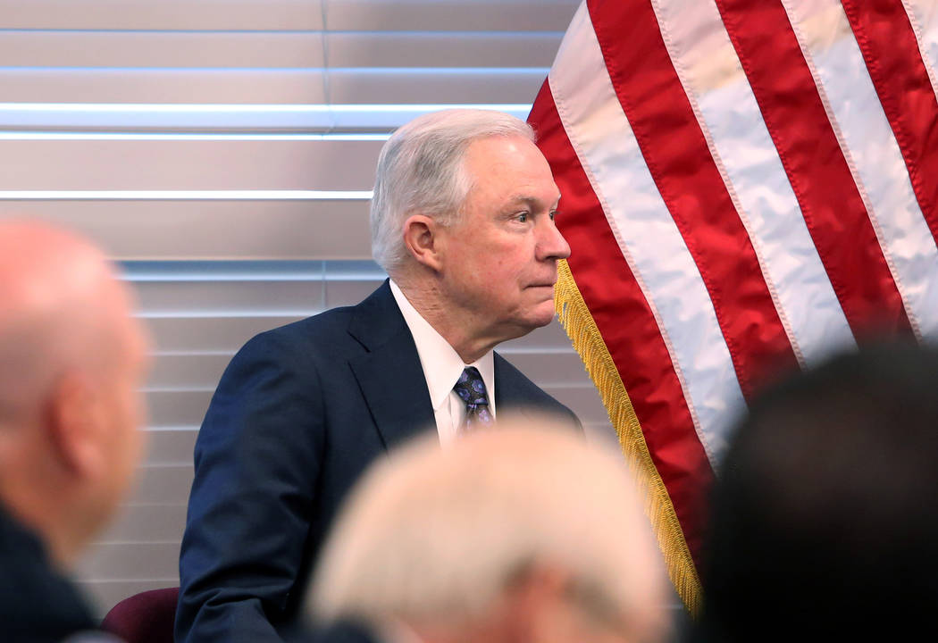 U.S. Attorney General Jeff Sessions waits to be introduced before speaking to federal, state and local law enforcement officials about sanctuary cities and efforts to combat violent crime on Wedne ...